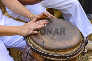 Young woman hands playing drum