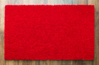 Blank Red Welcome Mat On Wood Floor Background Ready For Your Own Text