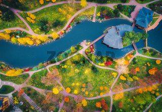 Aerial view of amazing autumn park with pond in europe