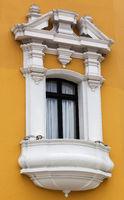 balcony and window on the yellow house
