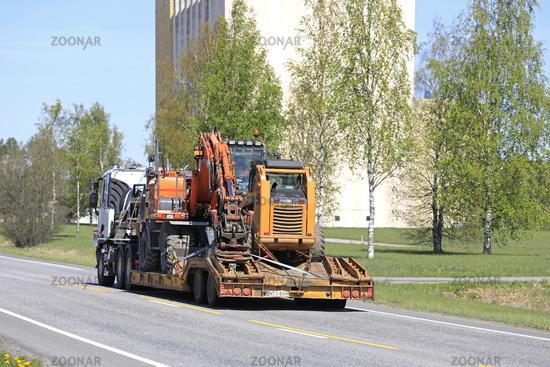 Semi Trailer Hauls Construction Machinery