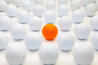 Pattern with white and orange golf balls