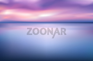 horizontal wide blue pink sky blurred background. Sunset and sunrise sea blurred background