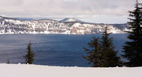 Fresh Winter Snow Falls on the Banks of Crater Lake in Oregon State