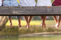 people sitting at wooden bridge
