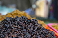 Close up of black dried grapes for sale in local market, Pune Maharashtra.