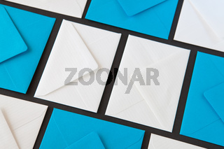 Composition with white and blue envelopes on the table.