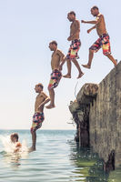 Man jumping from pier