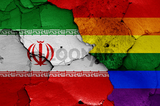 flags of Iran and LGBT painted on cracked wall