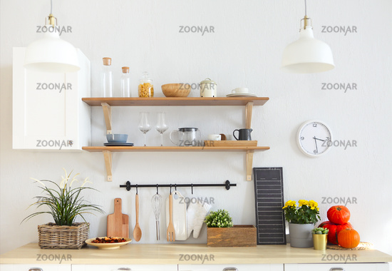 Interior of empty modern white kitchen with various objects