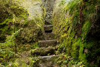 Narrow staircase of stone in rock