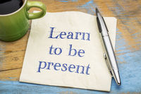 Learn to be present - text on napkin
