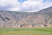 Mongolian mountain natural landscapes with eroded foothill slopes near lake Tolbo-Nuur in north Mongolia