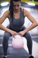 woman exercise with fitness kettlebell