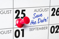 Wall calendar with a red pin - August 25