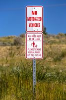 View of no motorized vehicles and dog leash sign