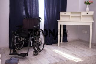 Empty wheelchair in room.