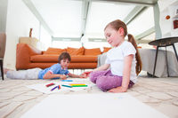 Children drawing with color pencils