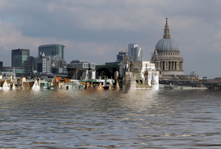 manipulated conceptual image of the city of london with historic buildings flooded due to global warming and rising sea levels
