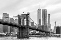 Brooklyn Bridge and Manhattan skyline in black and white, New York, USA.