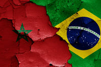 flags of Morocco and Brazil painted on cracked wall