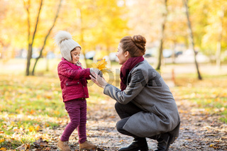 happy family with autumn leaves at park