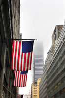 American flags on a pole, fluttering in the wind