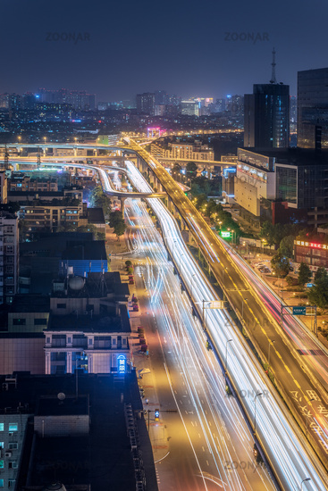 Busy car traffic on ChengWenLiJiao interchange aerial view at night