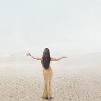 Beautiful young woman dancing belly dance outdoor