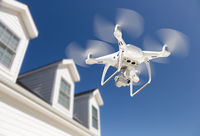 Drone Quadcopter Flying, Inspecting and Photographing House
