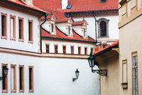 tile roofs of old white houses