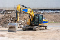 Yellow earth mover at a construction site