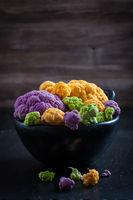 Colorful cauliflower on dark background