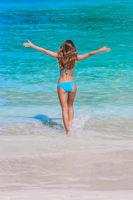 Girl walking to sea