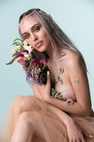 Gorgeous sexy girl-elf with flowers portrait