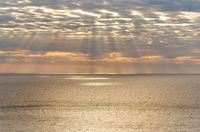 Light rays over Mediterranean sea at sunset. Ibiza Island, Balearic IIslands. Spain