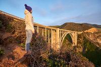 Woman tourist near Bixby Creek Bridge in California