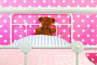 Pink bedroom with toy bear