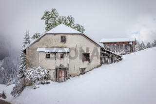 Old, abandoned mountain farm in winter