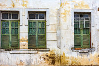 Facade and windows of damaged old houses built in Ouro Preto city