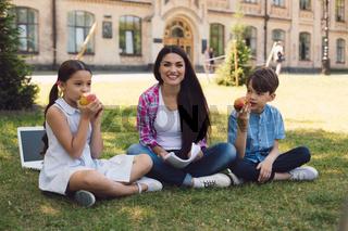 Teacher giving apple to kid