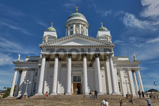 Visitors entering the Cathedral of the Diocese of Helsinki, finnish Evangelical Lutheran church, located in the neighborhood of Kruununhaka in Helsinki, Finland