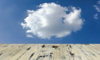 old painted washed oak wooden table on the blue sky clouds background, wood table
