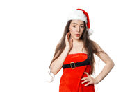 sexy lady dressed in christmas costume and santa hat with pursed lips