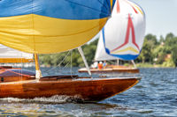 classic sailing yacht with spinnaker on a lake in a regatta