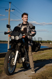Handsome baker mounts his motorcycle