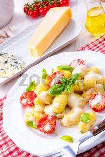 delicious gnocchi with gorgonzola cream sauce and cherry tomatoes