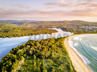 Early morning light over coastal beaches and river