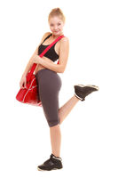 Sport. Fitness sporty girl in sportswear with gym bag
