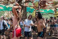 People dance on the main stage of the Lost Theory psytransce music festival held in Riomalo de Abajo